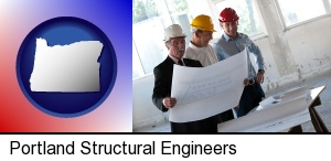 Portland, Oregon - a structural engineer discussing plans with manager and foreman
