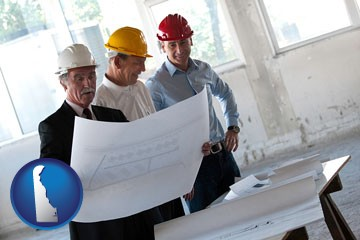 a structural engineer discussing plans with manager and foreman - with Delaware icon