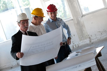 a structural engineer discussing plans with manager and foreman